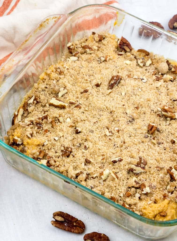 streusel topping sprinkled over pumpkin coffee cake batter