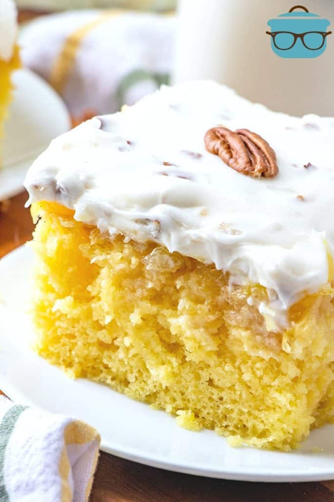 closeup, slice of yellow pineapple cake with homemade pecan cream cheese frosting