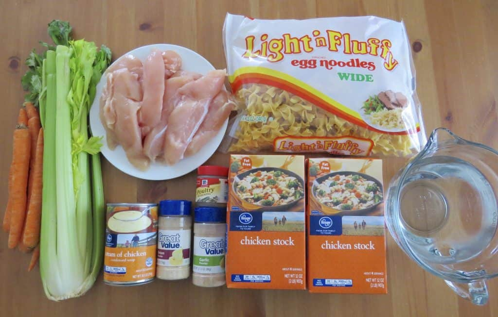 Chicken Noodle Soup ingredients: chicken stock poultry seasoning, garlic powder ,onion powder, boneless chicken (breasts, thighs or tenderloins), diced carrots, diced celery, cream of chicken soup, water, egg noodles, salt & pepper