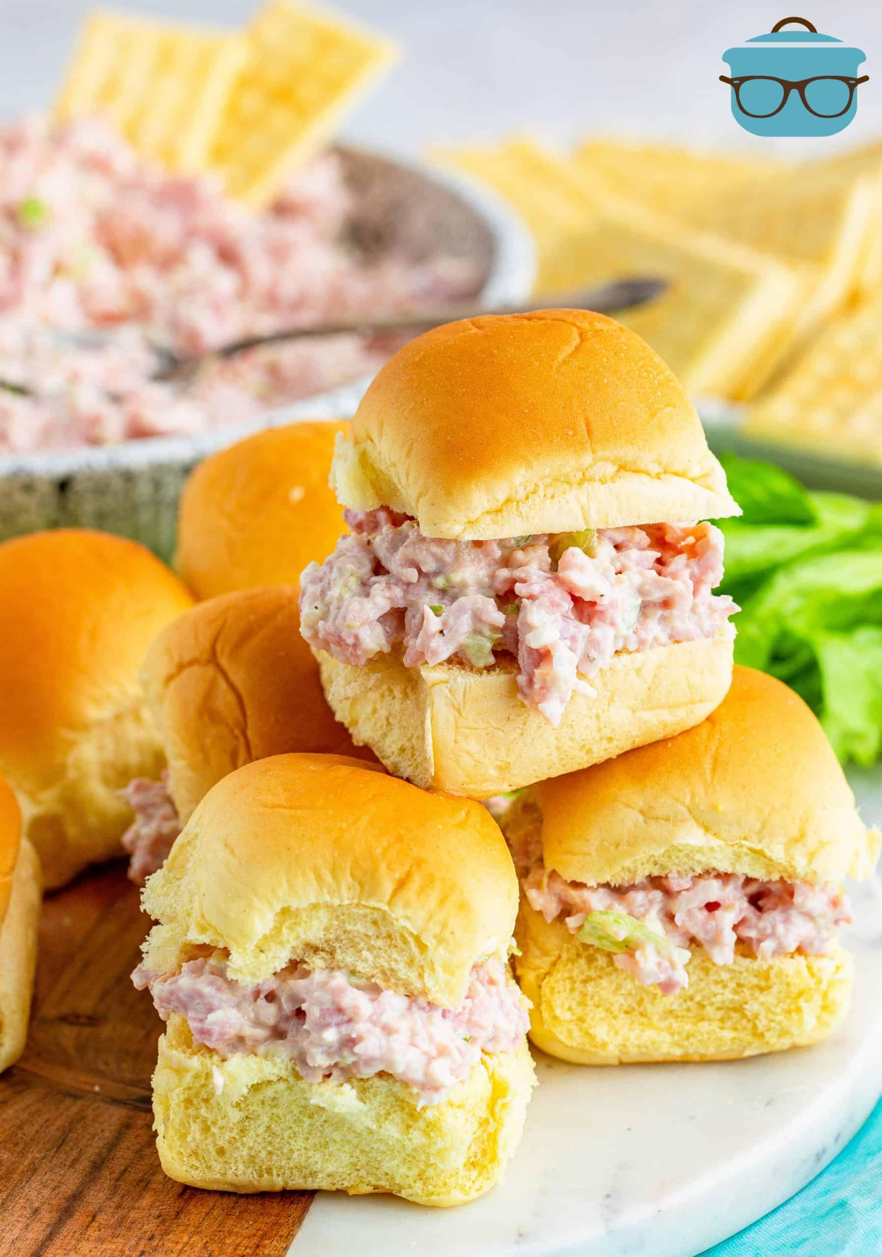 ham salad shown on Hawaiian Sweet Rolls stacked on a plate