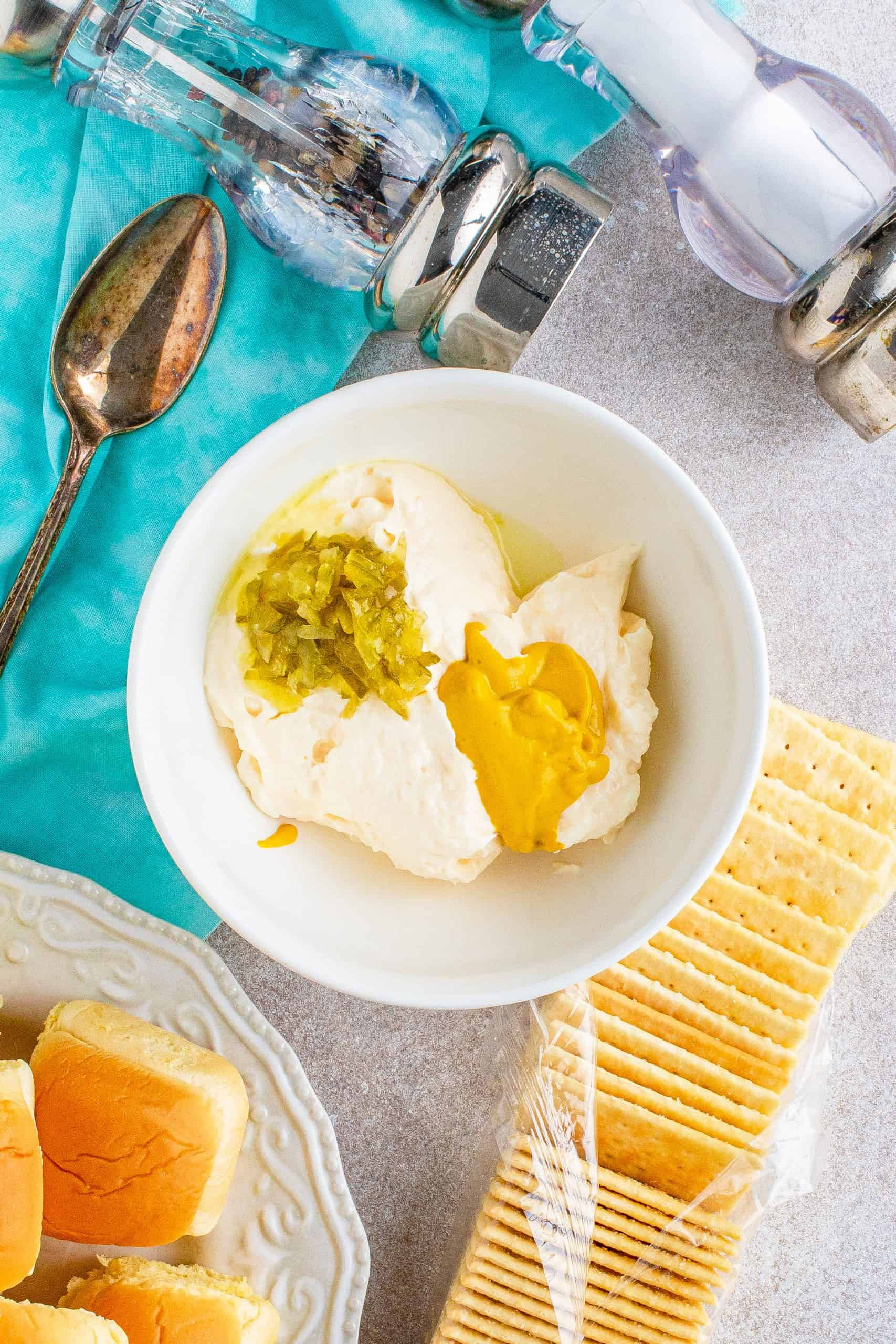 mayonnaise, mustard and sweet pickle relish in a medium white bowl