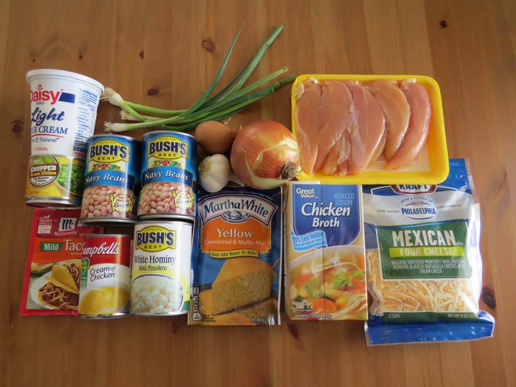chicken tenders, chicken broth, Navy beans, taco seasoning, hominy, sour cream, chopped green chiles, onion, garlic, cornbread mix