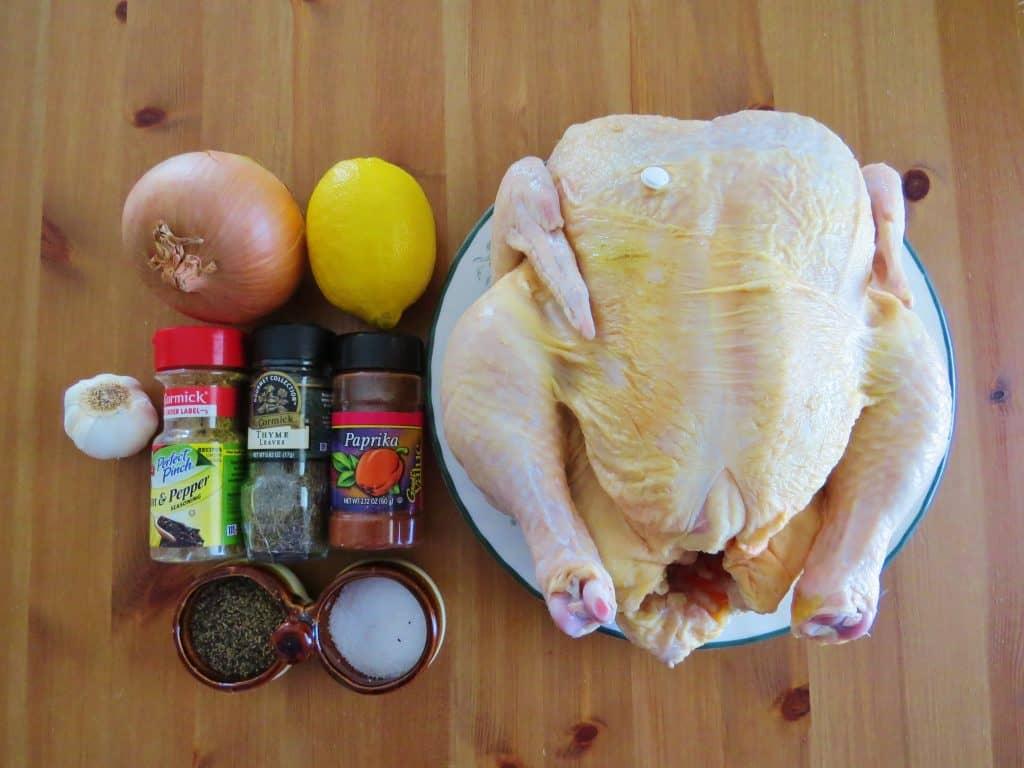 whole chicken, lemon, onion, garlic, lemon pepper seasoning, dried thyme, paprika, salt, pepper