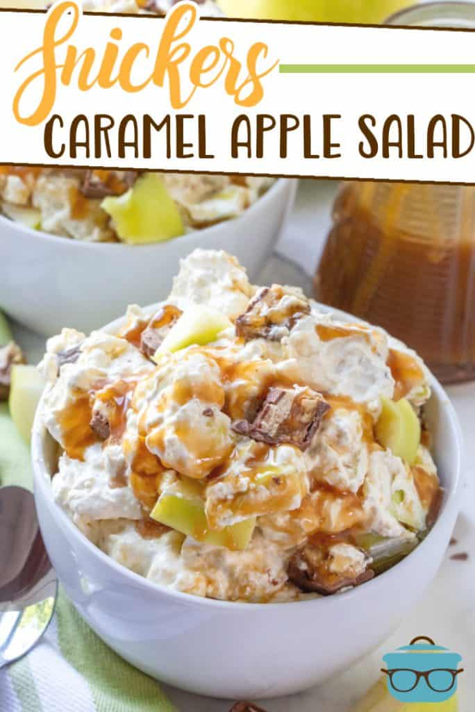 Snickers Caramel Apple Salad recipe from The Country Cook, shown served in small white bowls with a jar of caramel sauce in the background