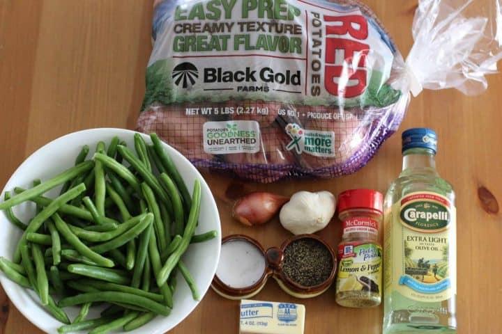 red potatoes, fresh green beans, olive oil, lemon pepper seasoning, shallot, garlic cloves, butter, salt and pepper