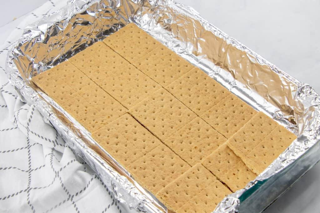 graham cracker squares layered in a 9X13 baking pan