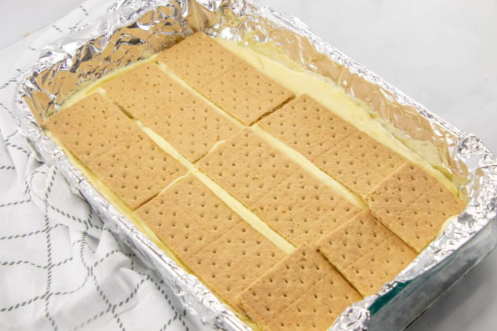 layer of graham cracker squares on top of vanilla pudding