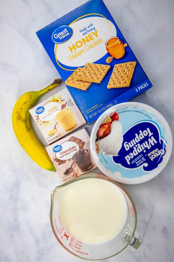 vanilla instant pudding mix, cold milk, chocolate instant pudding mix, whipped topping (COOL WHIP,) banana, graham cracker squares