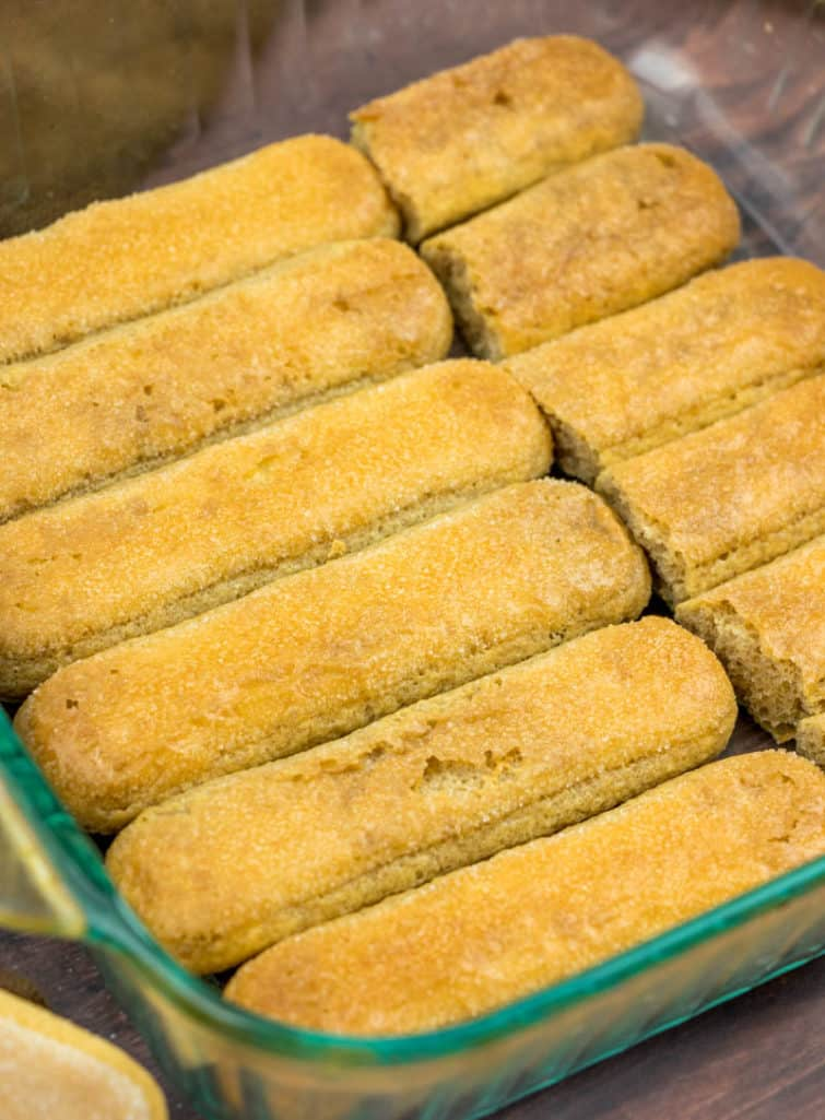 lady fingers lined up in a square baking dish