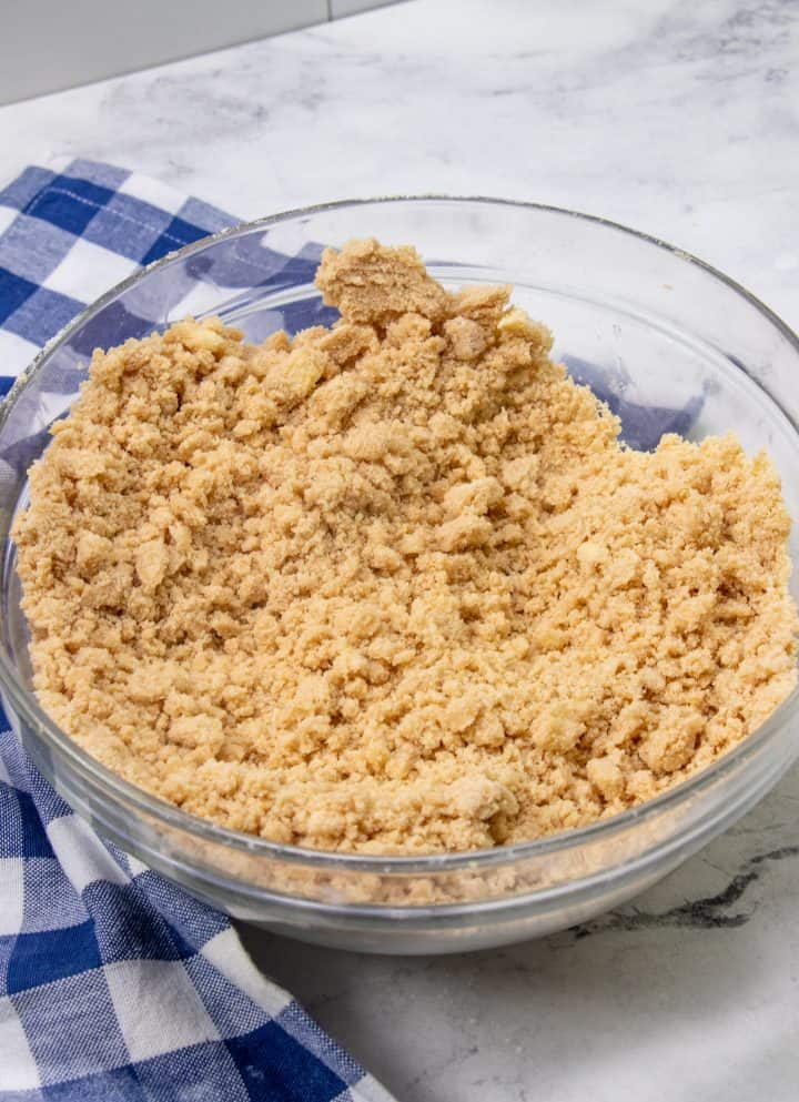 crumbled pieces of brown sugar and butter in a glass bowl