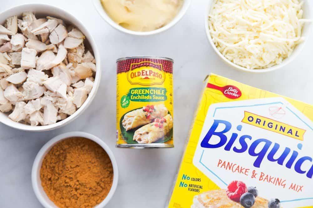 Bisquick pancake and biscuit mix, rotisserie chicken, taco seasoning, mozzarella, cream of chicken soup, refried beans, green Chile enchilada sauce