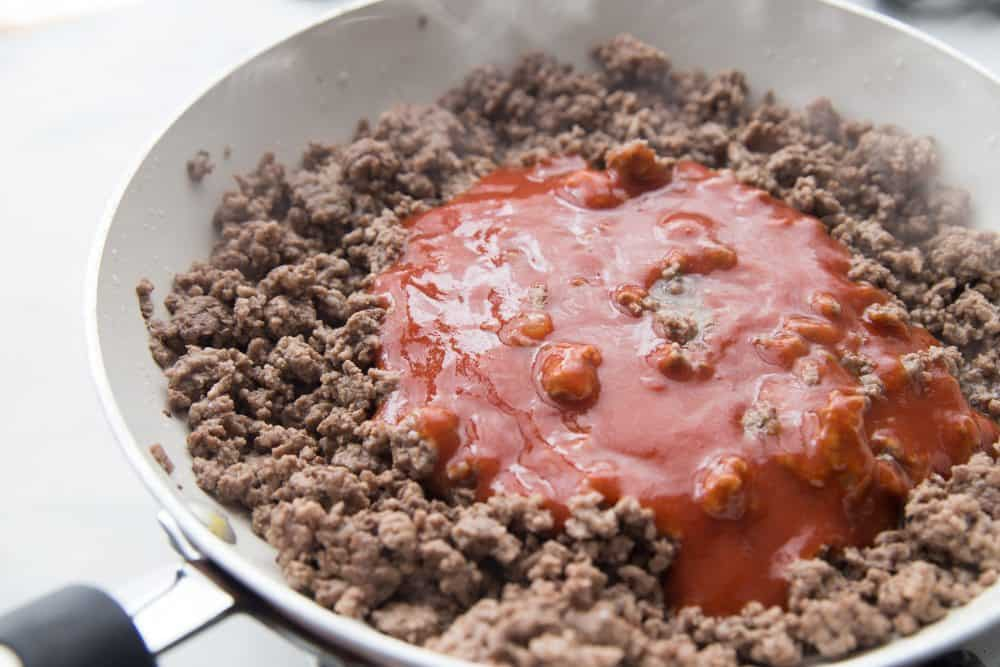 cooked ground beef with taco sauce