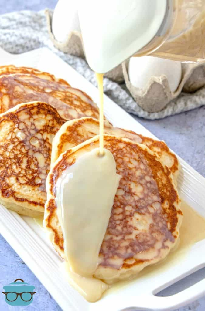 Griddle-fried Buttermilk Pancakes with Maple Butter Sauce poured on top
