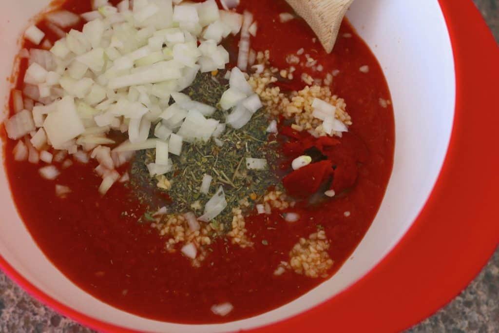 crushed tomatoes, tomato sauce, diced onions, Italian seasoning and minced garlic
