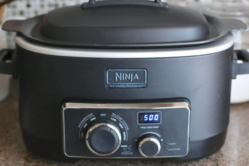 covered Ninja slow cooker set for five hours