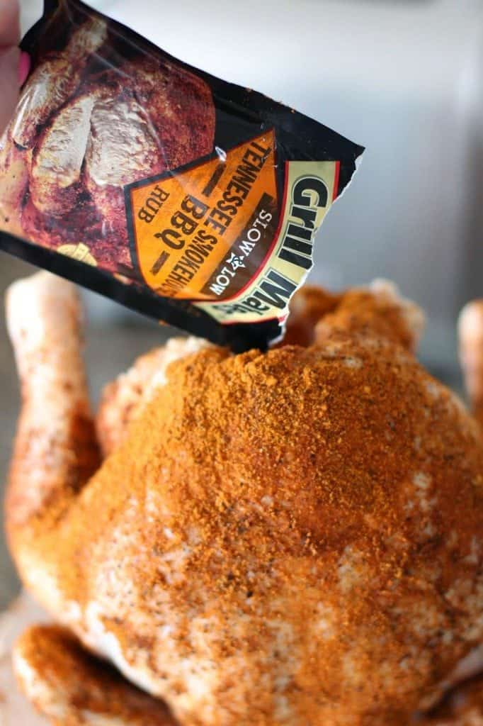seasoning chicken with BBQ chicken rub seasoning