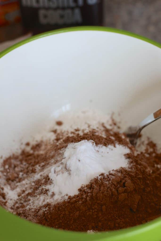 flour, baking soda and cocoa mixed together in a bowl