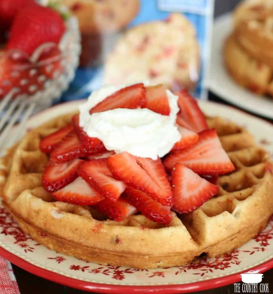 Strawberry Muffin Mix Belgian Waffles with macerated strawberries and whipped cream