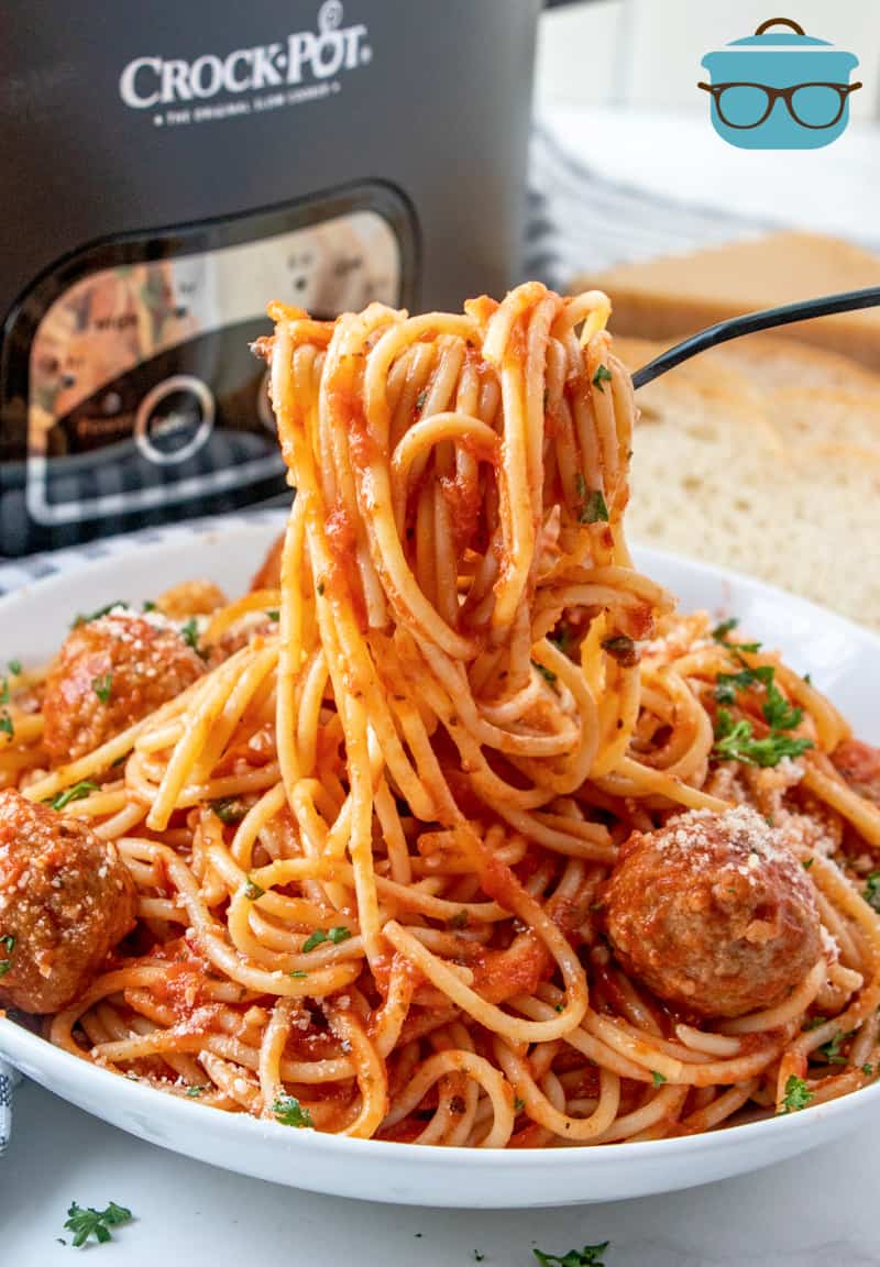 forkful holding up some spaghetti coated with spaghetti sauce