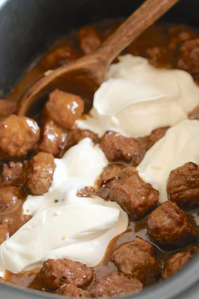 sour cream added to cooked meatballs and gravy