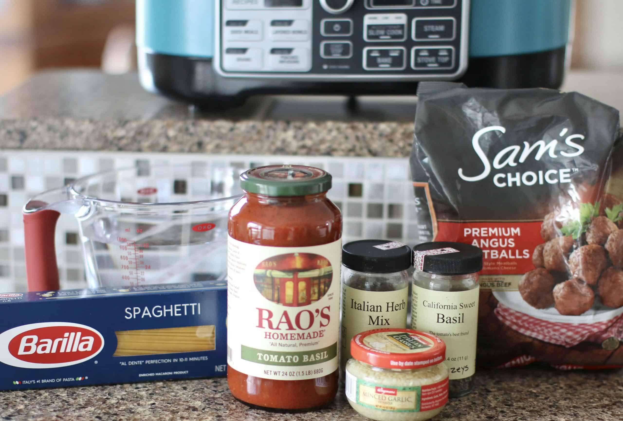 Crock Pot Spaghetti and Meatballs ingredients: spaghetti sauce, frozen meatballs, water, Italian seasoning, minced garlic, dried basil,spaghetti noodles, olive oil