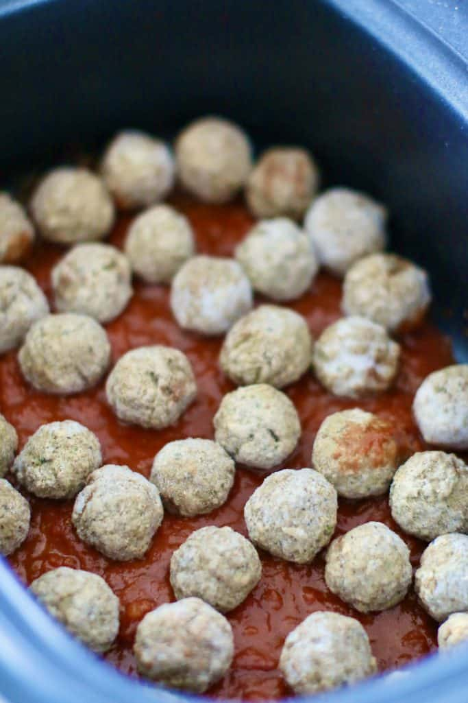 layer of spaghetti sauce and layer of frozen meatballs in an oval slow cooker