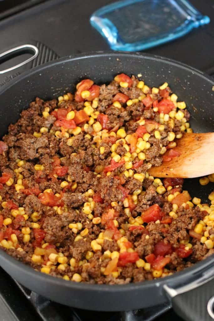 mexicorn and Rotel brand tomatoes added cooked ground beef mixture in large skillet