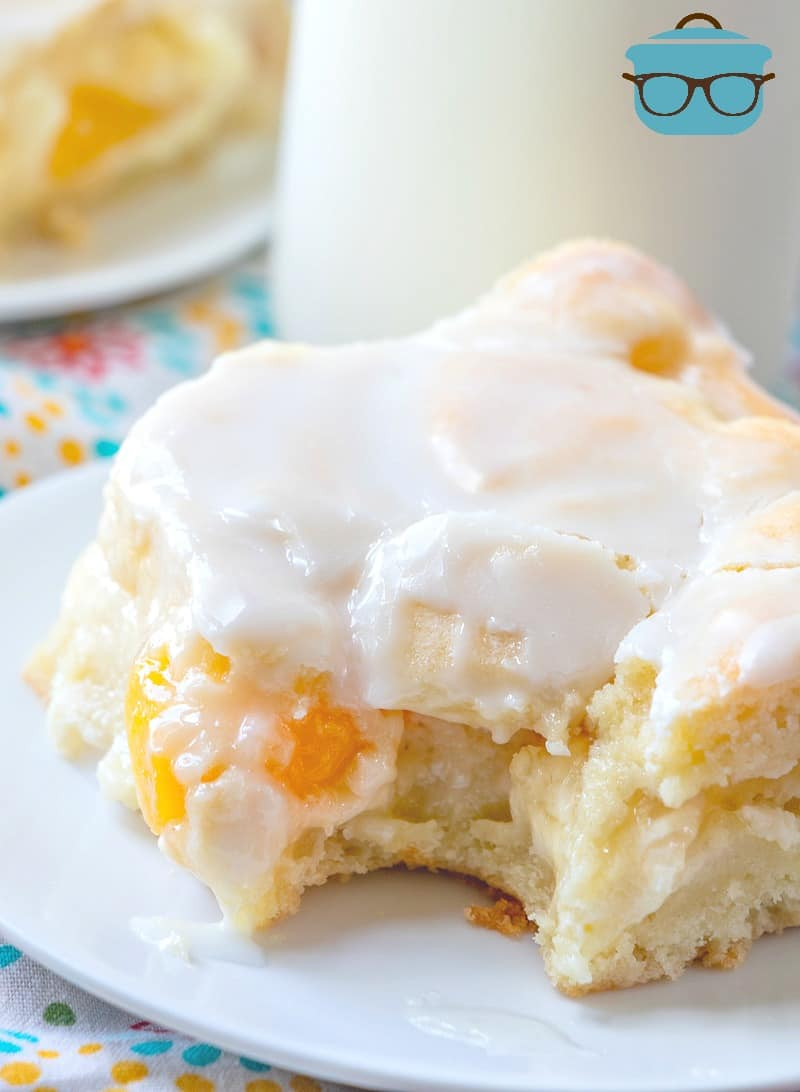 Peaches and Cream Bars, slice with bite taken out.