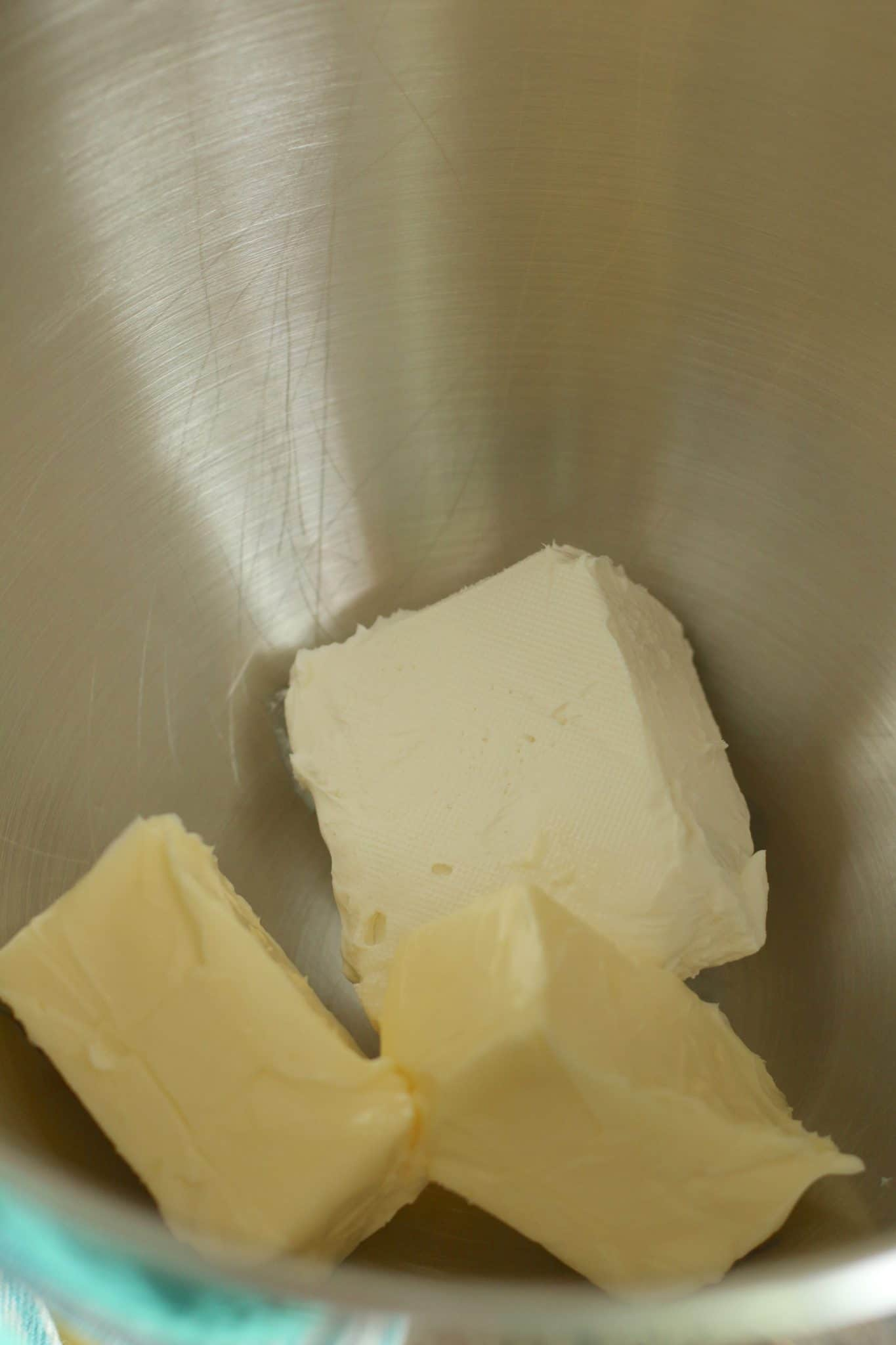 cream cheese and butter in the bowl of a stand mixer