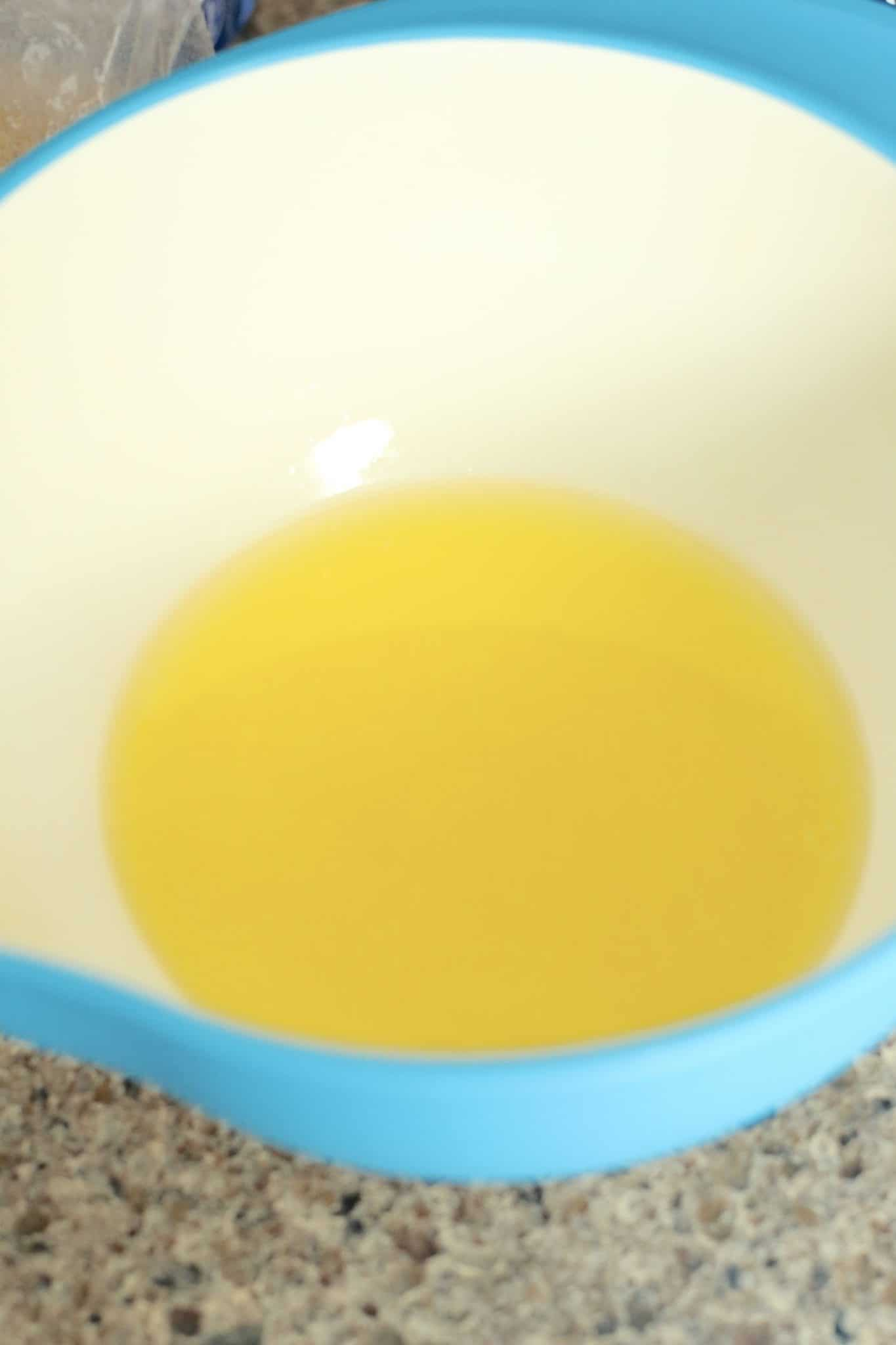 melted butter in the bottom of a bowl