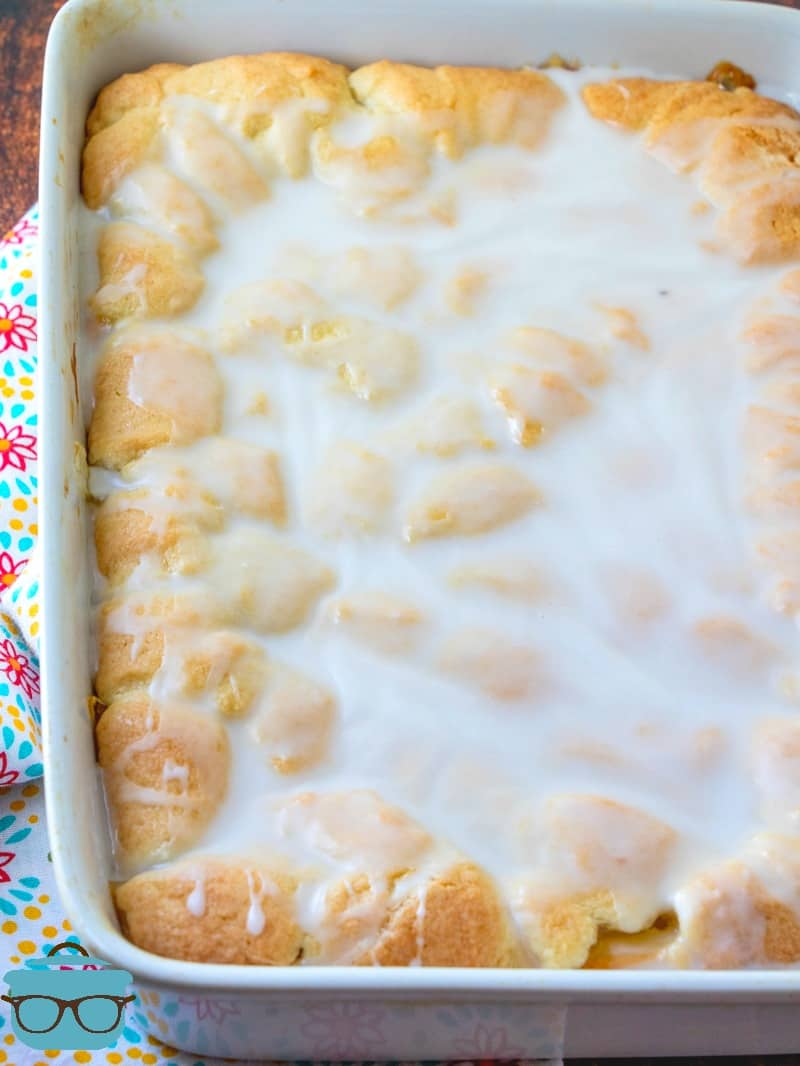 fully baked peaches and cream bars with icing on top.