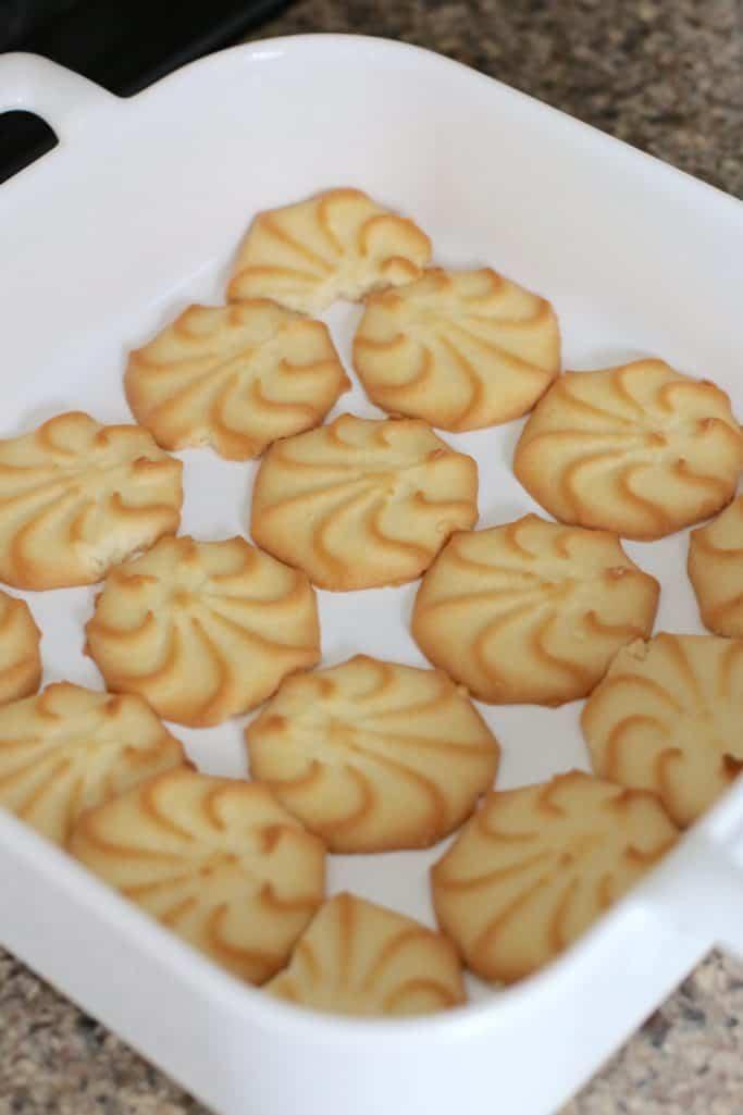 layering Pepperidge Farm Lemon cookies into the bottom of a square white Revol baking dish