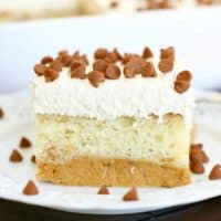 slice, Magic Layer Pumpkin Cake on a white plate topped with cinnamon chips