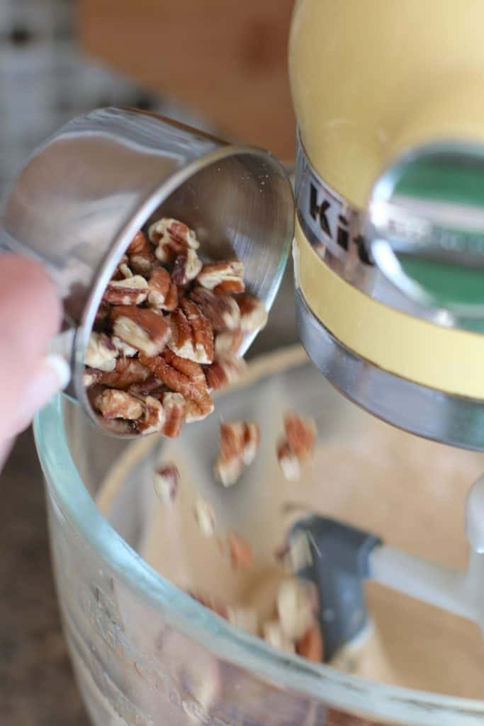 pecans added to muffin mix batter in a stand electric mixer