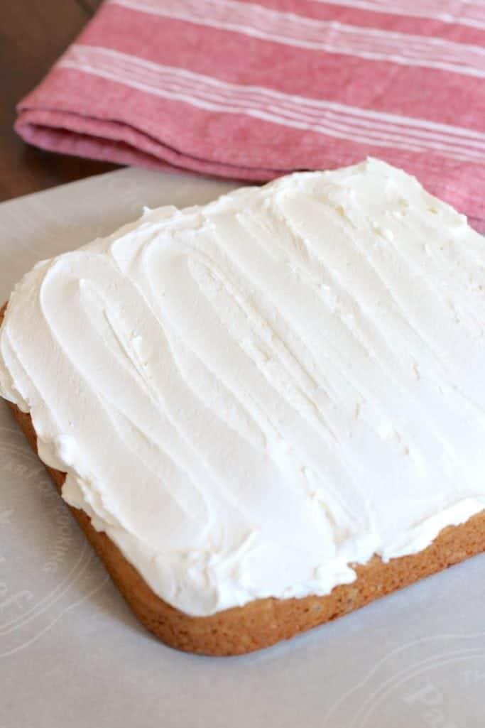 marshmallow fluff frosting spread onto sweet potato cake