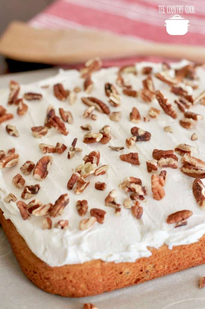 Sweet Potato Cake with Fluff Frosting and chopped pecans