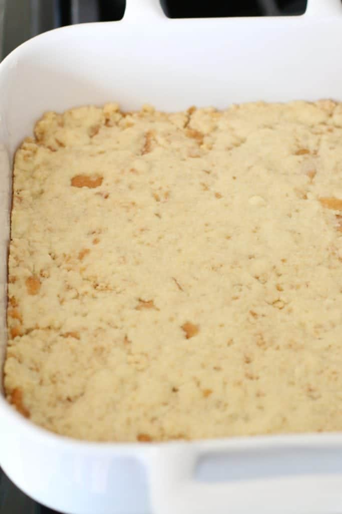 fully baked vanilla pie crust in a square Revol white baking dish