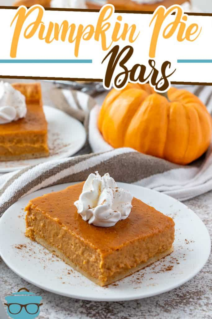Easy Pumpkin Pie Bars recipe from The Country Cook, bar shown on a white plate with small pumpkins in the background