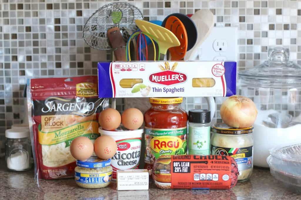 ground beef, spaghetti sauce, spaghetti, ricotta, mozzarella, onion, Italian seasoning, parmesan cheese, eggs