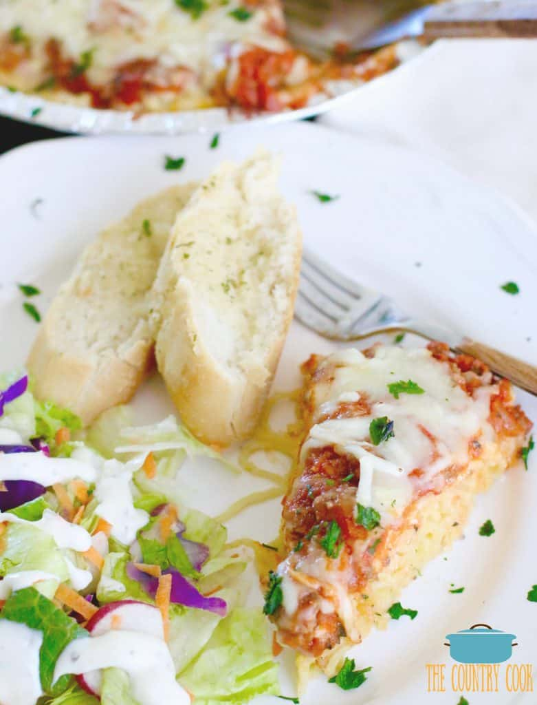 Baked Spaghetti Pie with salad and garlic bread