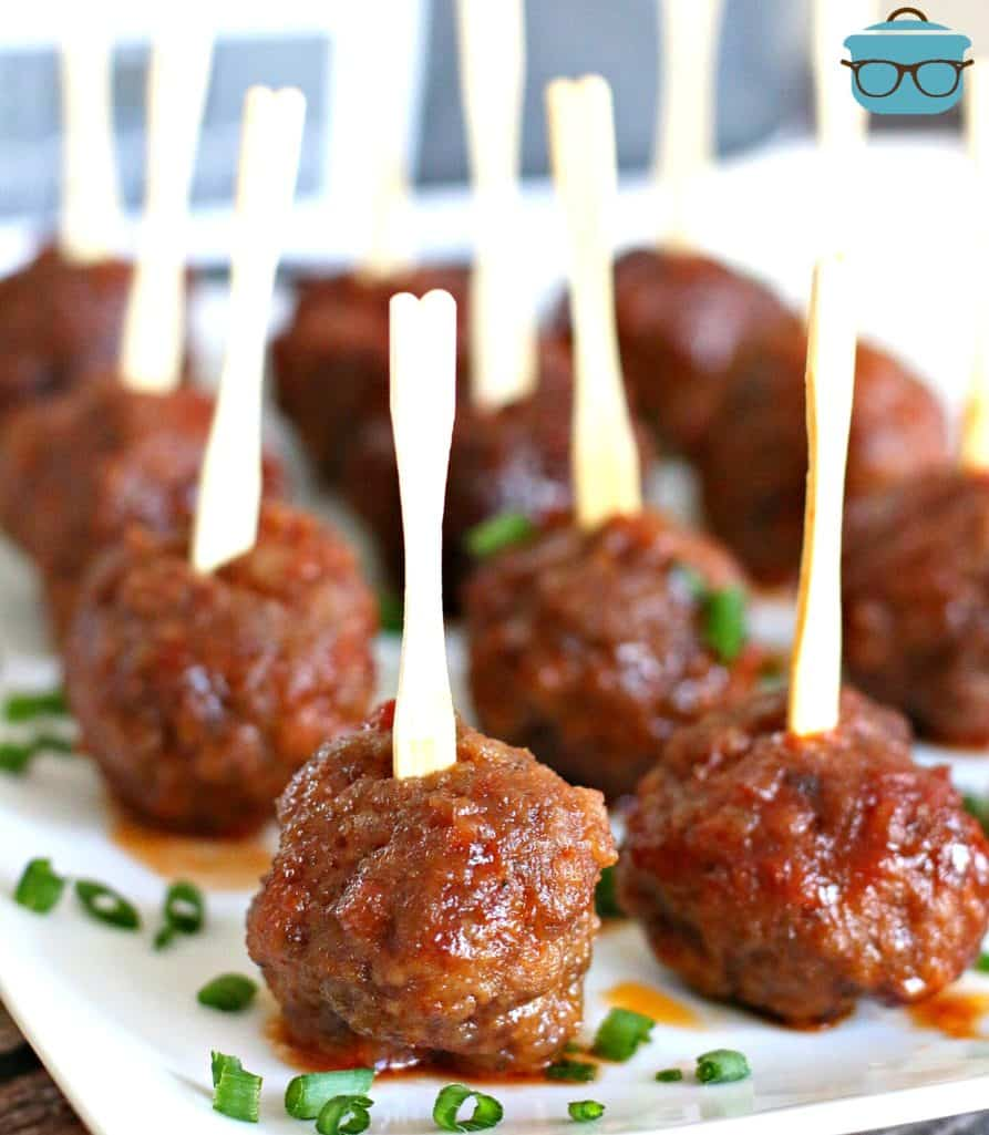 Homemade Appetizer Party Meatballs on a white platter sprinkled with sliced green onion