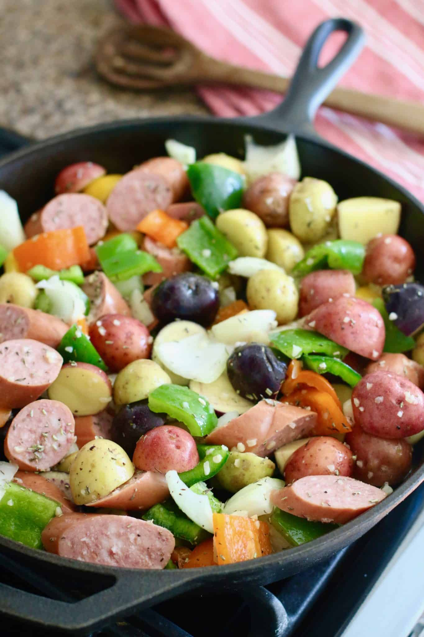 peppers and sausage in cast iron skillet