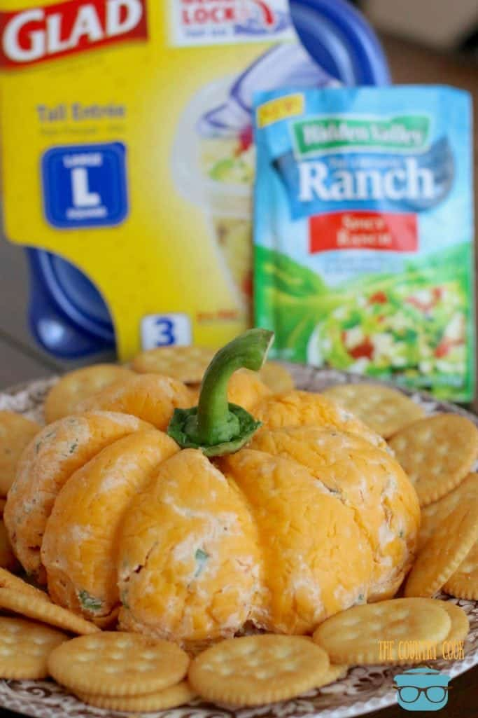 Pumpkin Shaped Cheeseball with ritz crackers and made with Hidden Valley Ranch Dressing Dip mix