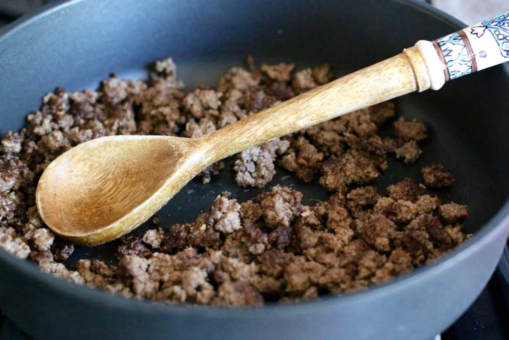 browning and crumbling ground beef in a large skillet