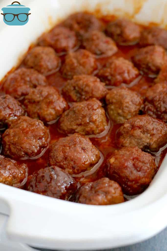fully cooked homemade meatballs covered in sauce in a casserole slow cooker