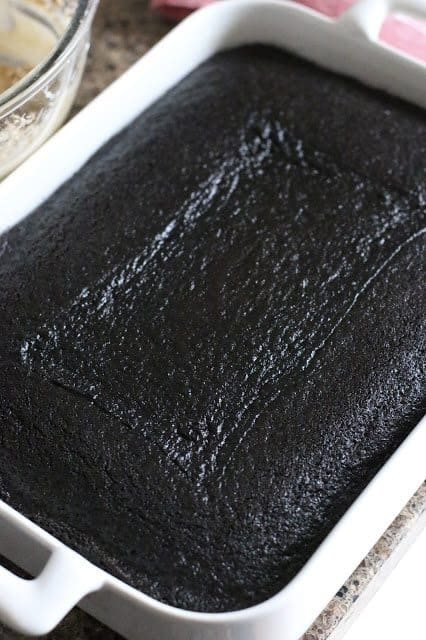 fully baked dark chocolate cake in a white baking dish