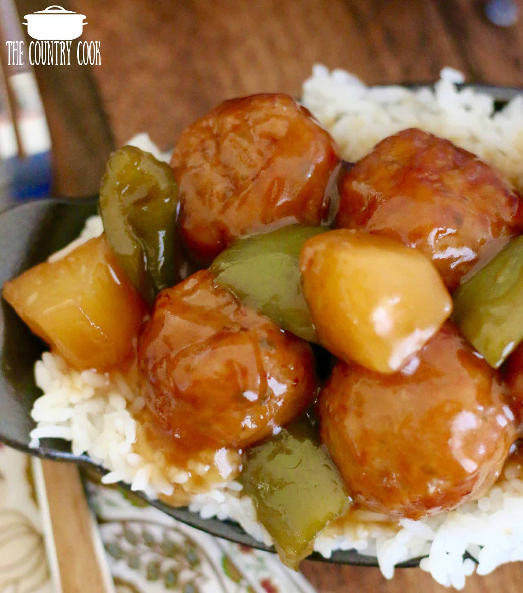 Crockpot Sweet and Sour Meatballs shown served over a serving of rice.