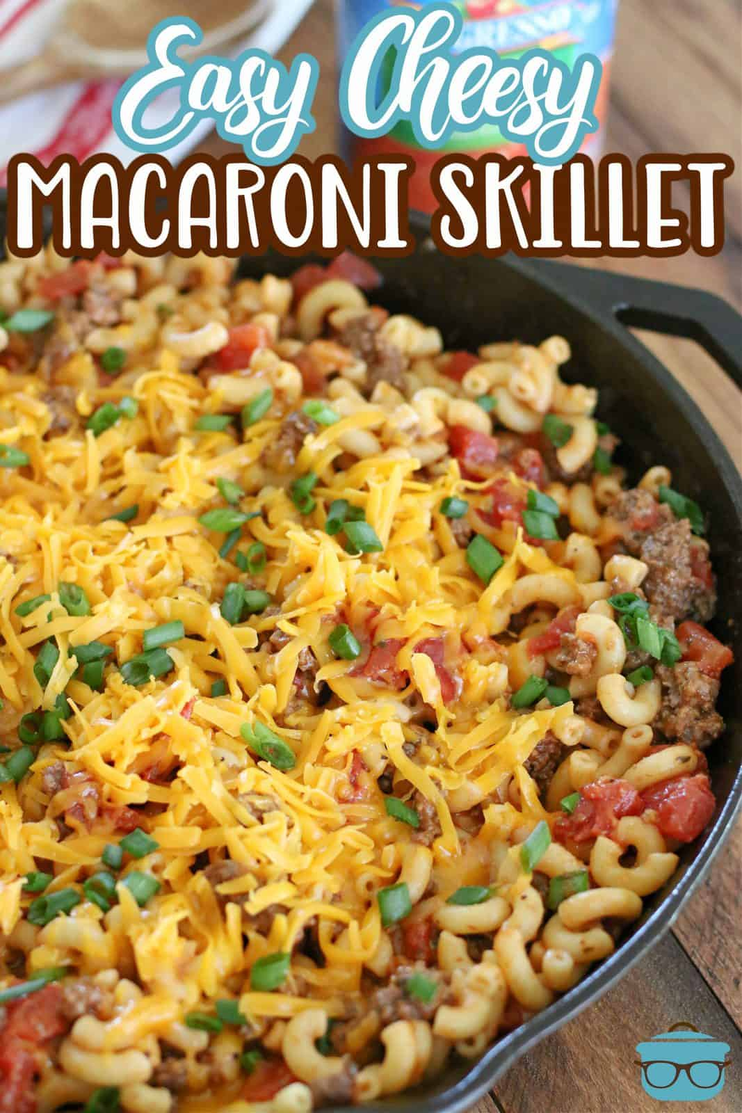 Easy Cheesy Tomato Macaroni Skillet recipe from The Country Cook. Fully cooked macaroni skillet meal in a cast iron skillet with cheese on top.