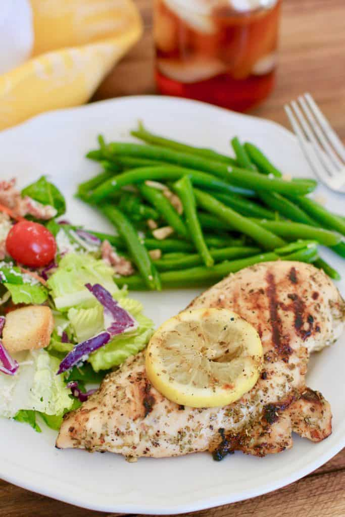 Grilled Italian Lemon Garlic Chicken with salad and green beans