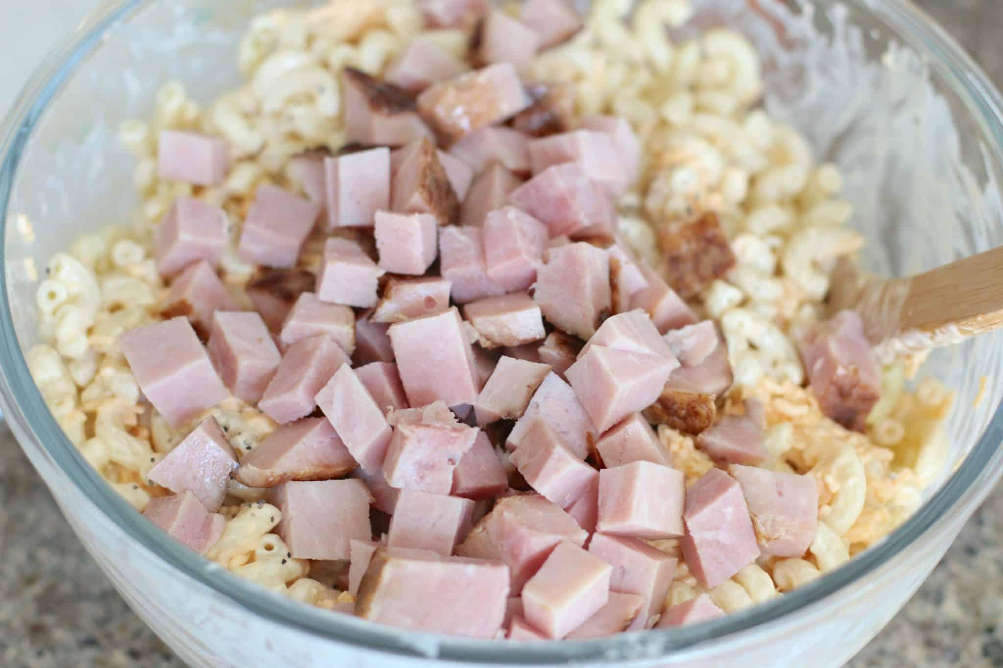 diced ham added into macaroni salad.